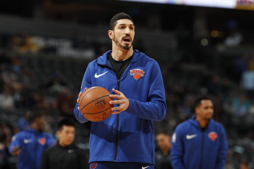 FILE - In this Jan. 1, 2019, file photo, New York Knicks center Enes Kanter, of Turkey, warms up prior to the team's NBA basketball game against the D...