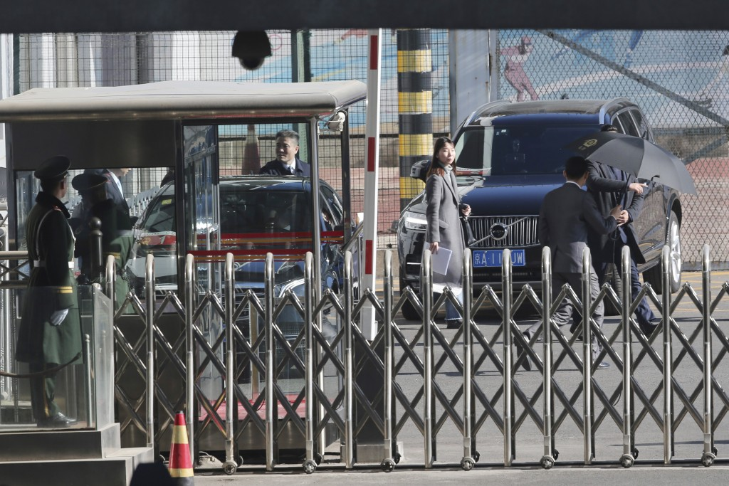 A car, left, carrying North Korean senior ruling party official and former intelligence chief Kim Yong Chol, prepares to leave from the VIP terminal o