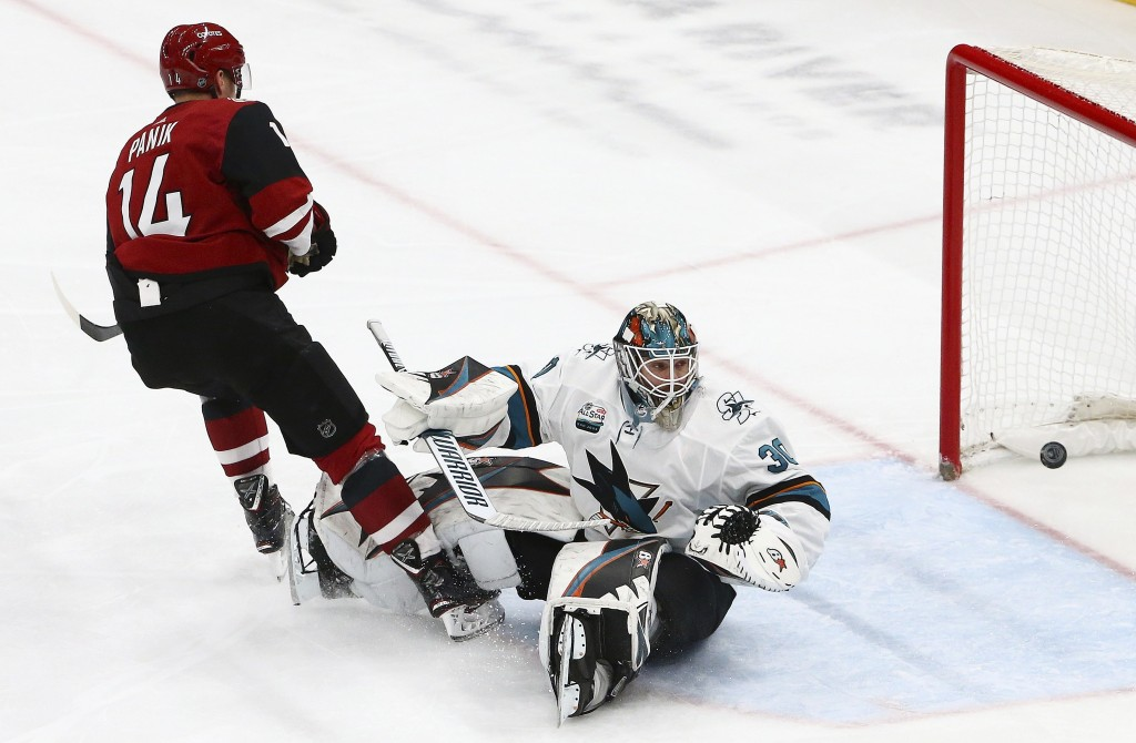 Arizona Coyotes right wing Richard Panik (14) scores a goal against San Jose Sharks goaltender Aaron Dell (30) during the first period of an NHL hocke