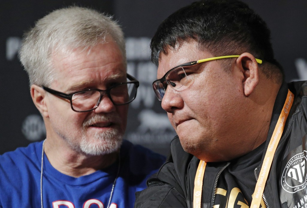 Buboy Fernandez, right, and Freddie Roach speak at a news conference for an upcoming fight between Manny Pacquiao and Adrien Broner, Wednesday, Jan. 1