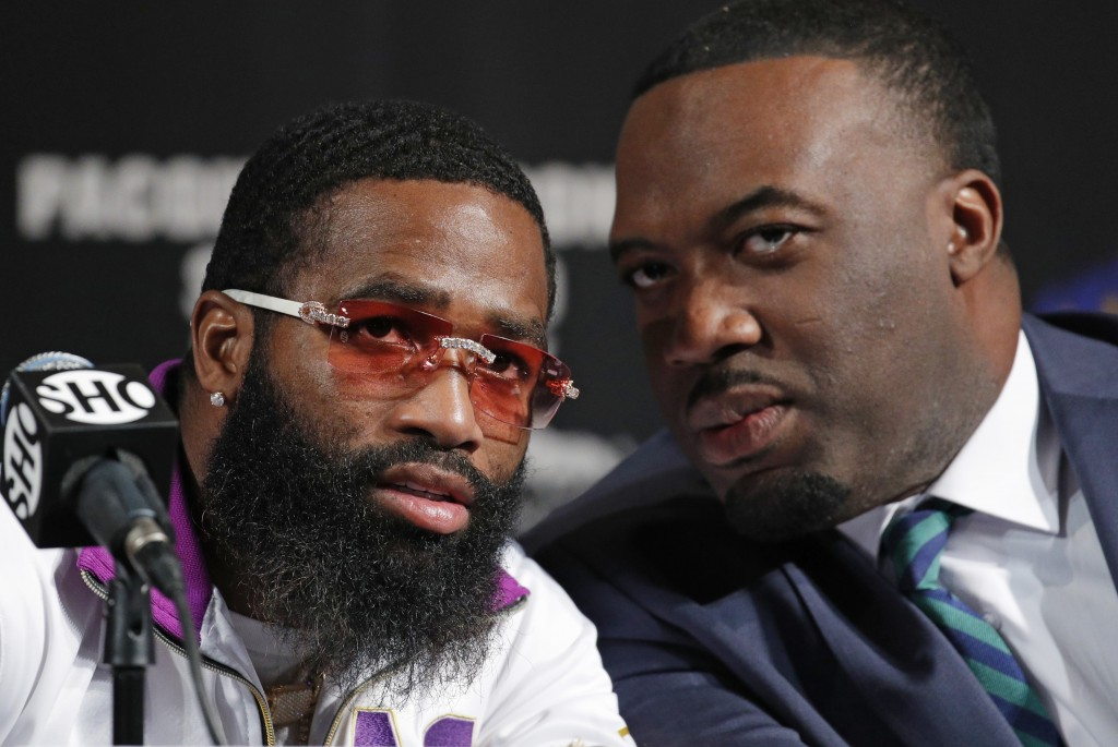 Adrien Broner, left, speaks with his advisor Ravone Littlejohn during a news conference Wednesday, Jan. 16, 2019, in Las Vegas. Broner is scheduled to