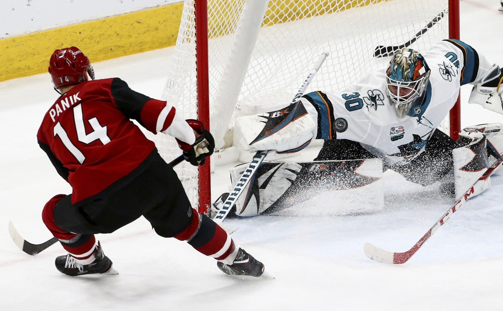 San Jose Sharks goaltender Aaron Dell (30) makes a save on a shot by Arizona Coyotes right wing Richard Panik (14) during the second period of an NHL