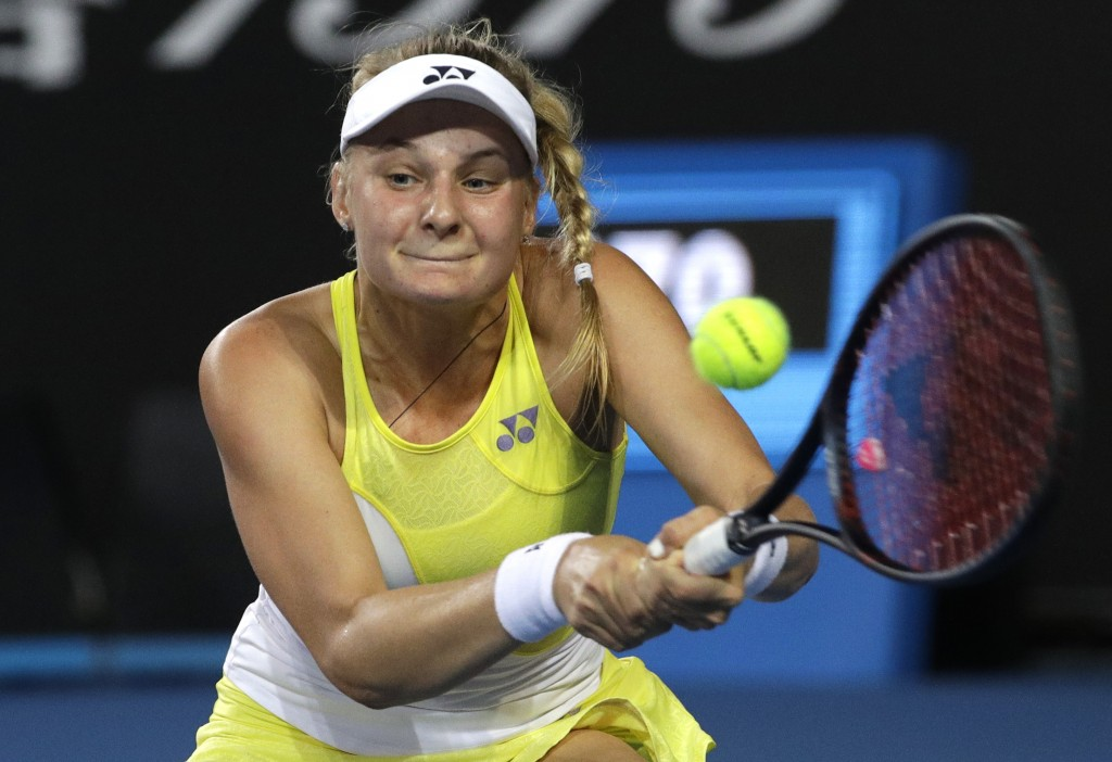 Ukraine's Dayana Yastremska makes a backhand return to Spain's Carla Suarez Navarro during their second round match at the Australian Open tennis cham