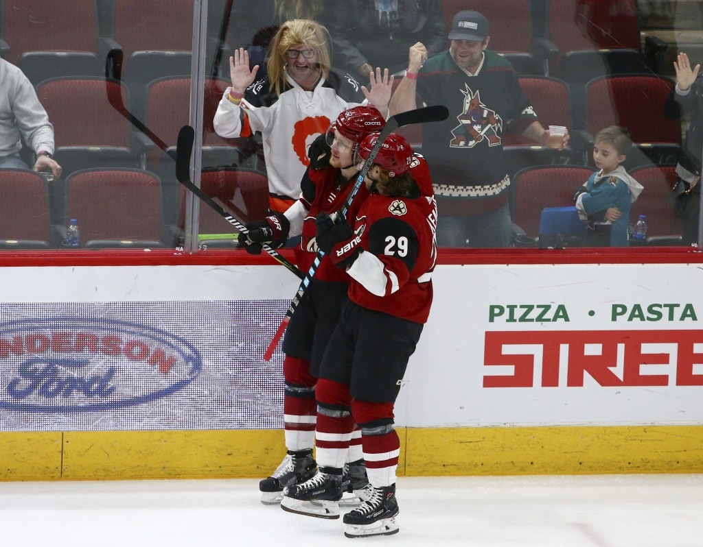Arizona Coyotes left wing Lawson Crouse, left, celebrates his goal against the San Jose Sharks with right wing Mario Kempe (29) during the first perio