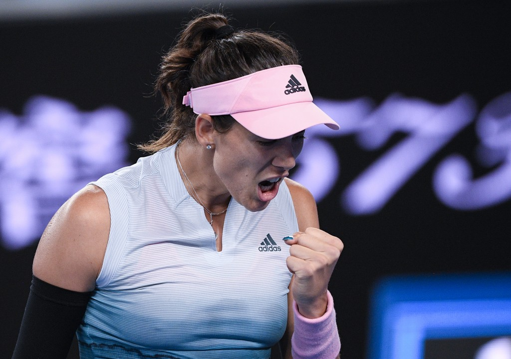Spain's Garbine Muguruza reacts after winning a point against Britain's Johanna Konta during their second round match at the Australian Open tennis ch