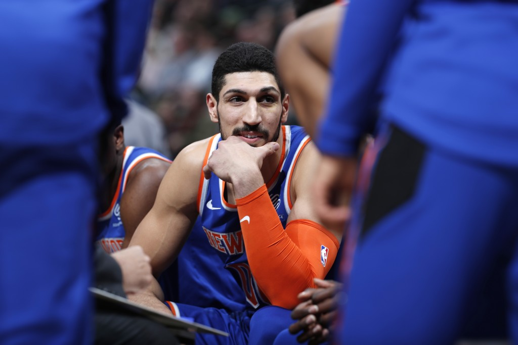 FILE - In this Jan. 1, 2019, file photo, New York Knicks centre Enes Kanter, of Turkey, jokes with teammates during a timeout the first half of the te...