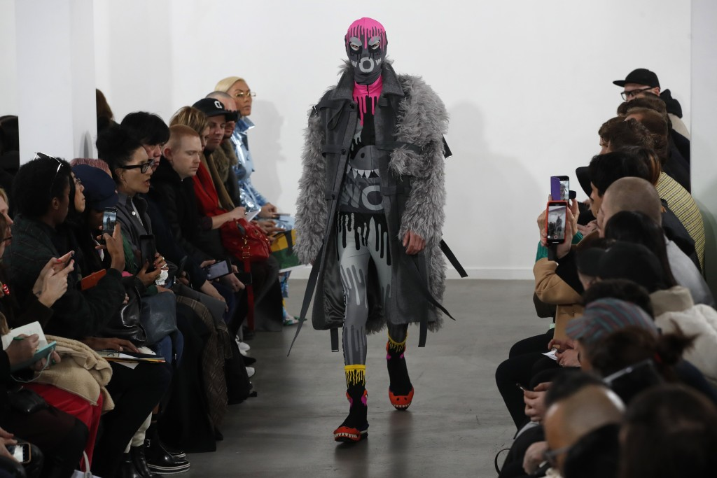 A model wears a creation for the Walter Van Beirendonck men's Fall/Winter 2019/20 fashion collection presented in Paris, Wednesday Jan.16, 2019. (AP P...