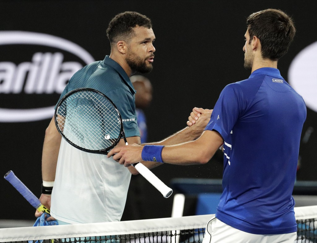 Serbia's Novak Djokovic, right, is congratulated by France's Jo-Wilfried Tsonga after winning their second round match at the Australian Open tennis c