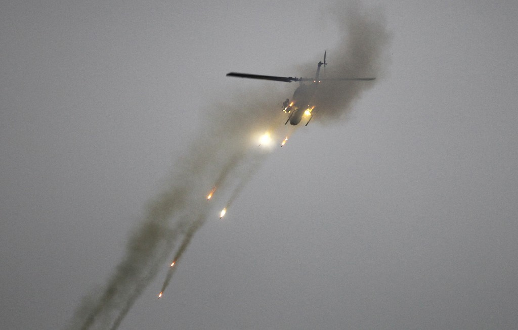 Taiwan's AH-1W Cobra attack helicopter fires during a military exercises in Taichung, central Taiwan, Thursday, Jan. 17, 2019. Taiwan's military has c