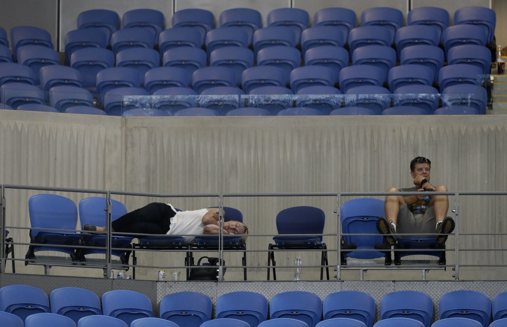 A spectator sleeps at Margaret Court Arena as Spain's Garbine Muguruza and Britain's Johanna Konta play their second round match at the Australian Ope
