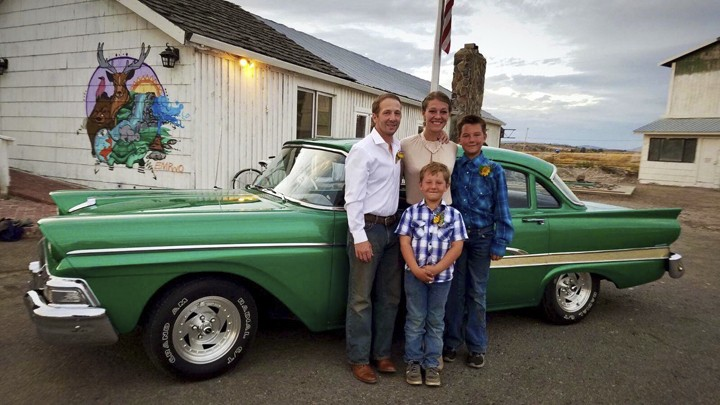 This recent photo provided by Jasmine Tool shows herself with her fiance Daniel Jastrab and their sons Jameson, right, and Silas. Tool, an ailing U.S....