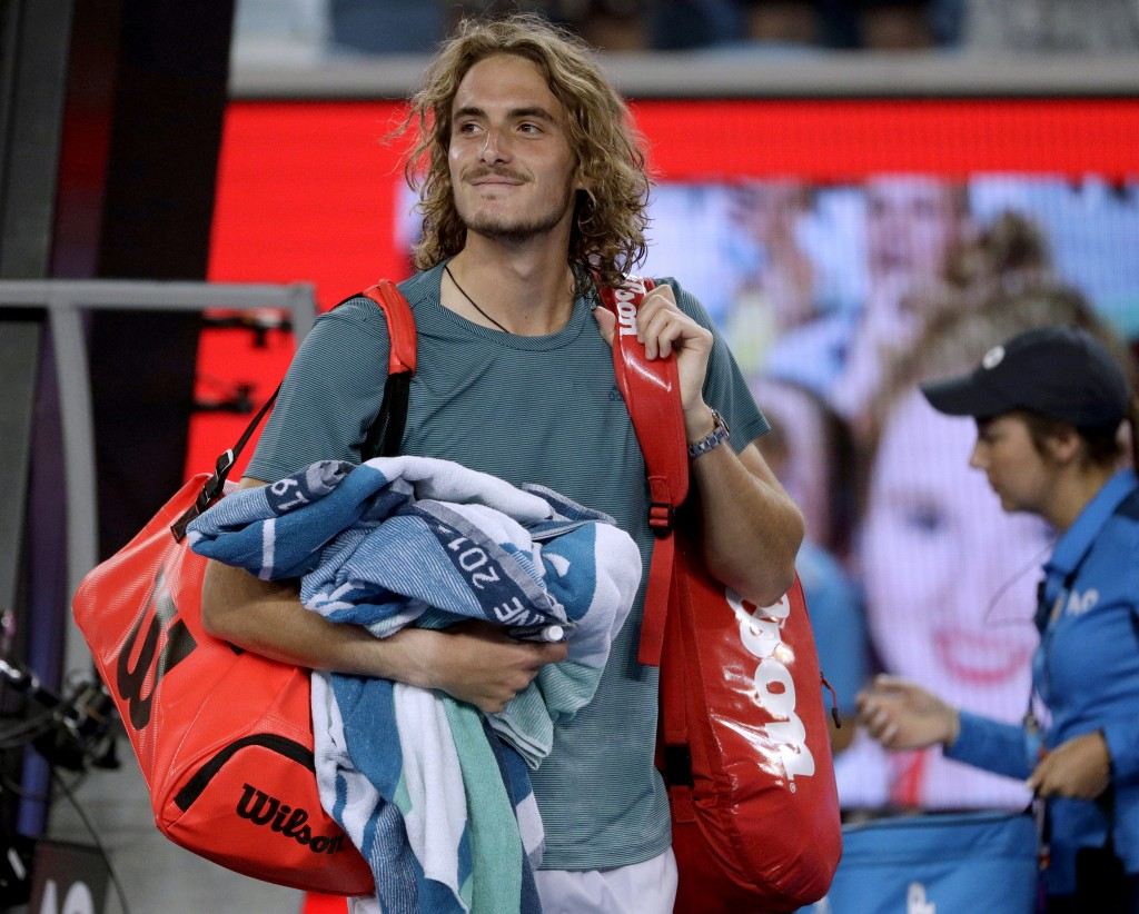 Greece's Stefanos Tsitsipas smiles as he leaves the court after defeating Georgia's Nikoloz Basilashvili during their third round match at the Austral...