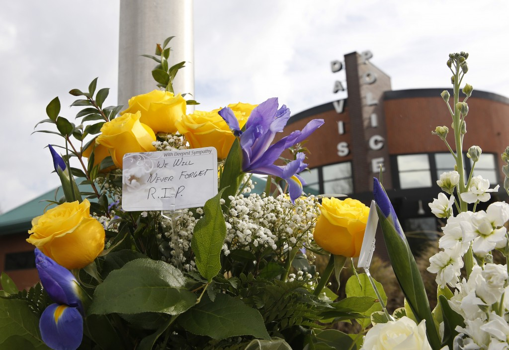 FILE - This Jan. 11, 2019, file photo shows flowers at a memorial outside of the Davis Police Department for slain Davis Police Officer Natalie Corona