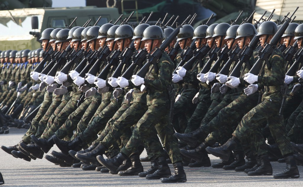 Thai soldiers parade during the Royal Thai Armed Forces Day ceremony at a military base in Bangkok, Thailand, Friday, Jan. 18, 2019. (AP Photo/Sakchai