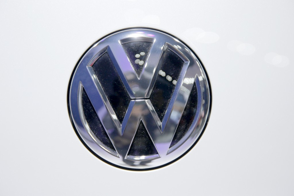 In this Wednesday, Feb. 3, 2016, photo, Volkswagen logo is seen on a vehicle displayed at the Auto Expo in Greater Noida, near New Delhi, India. The V