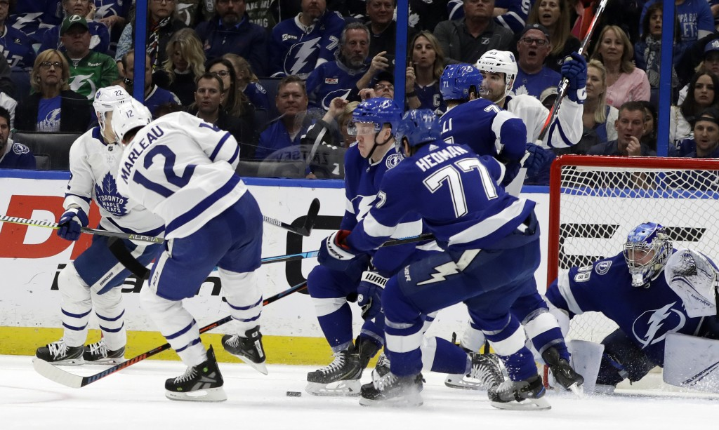Toronto Maple Leafs center Patrick Marleau (12) watches his shot eventually get past Tampa Bay Lightning goaltender Andrei Vasilevskiy (88) for a goal