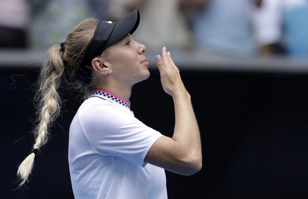 United States' Amanda Anisimova celebrates after defeating Aryna Sabalenka of Belarus during their third round match at the Australian Open tennis cha...