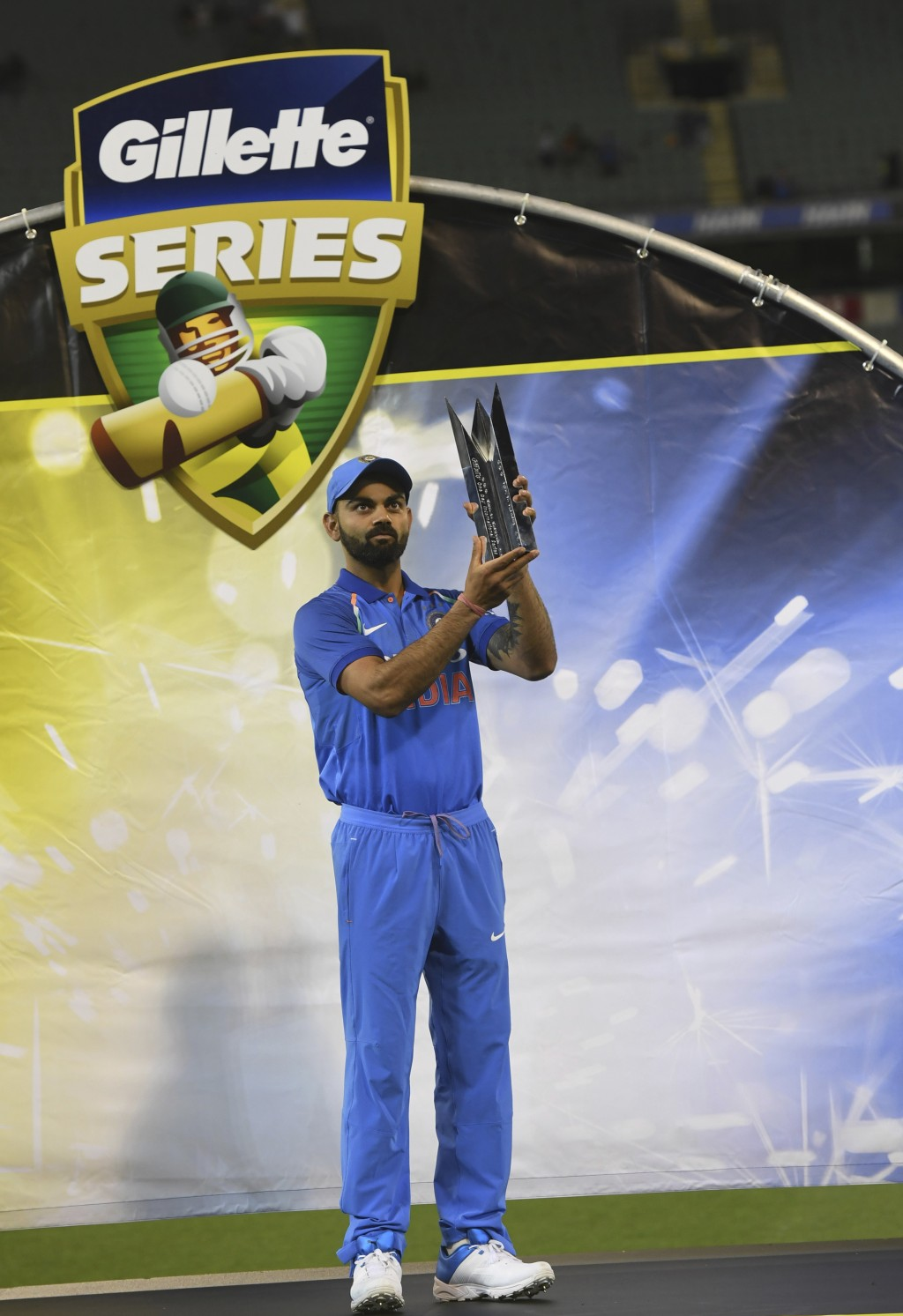 India's Virat Kohli poses with the Border–Gavaskar Trophy during their one day international cricket match against Australia in Melbourne, Australia,