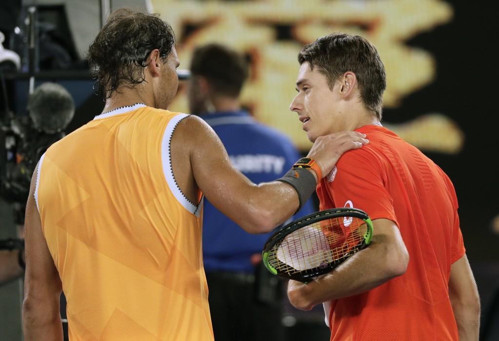 Spain's Rafael Nadal, left, is congratulated by Australia's Alex de Minaur after winning their third round match at the Australian Open tennis champio