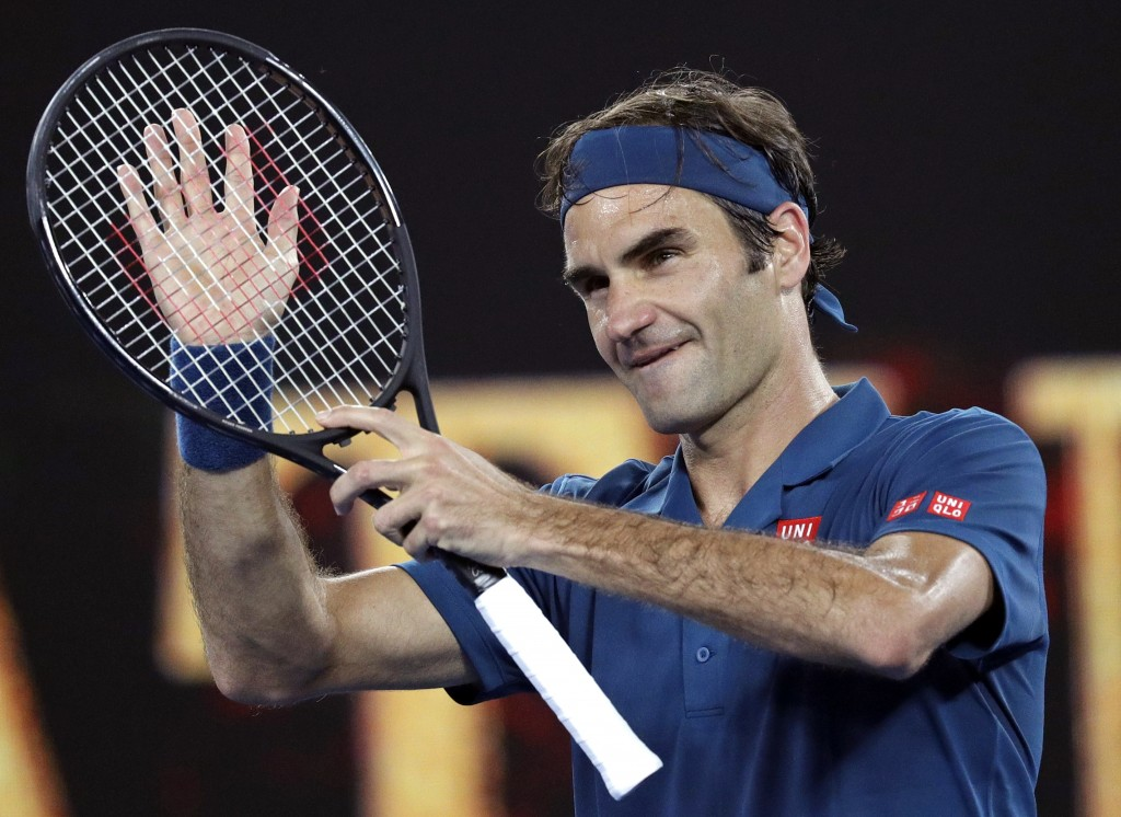 Switzerland's Roger Federer celebrates after defeating United States' Taylor Fritz during their third round match at the Australian Open tennis champi