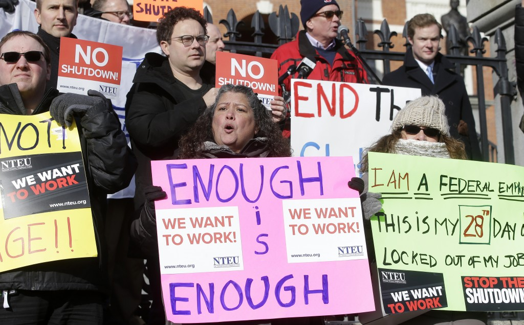 Internal Revenue Service employees, front row from the left, Brian Lanouette, of Merrimack, N.H., Mary Maldonado, of Dracut, Mass., and Maria Zangari,...