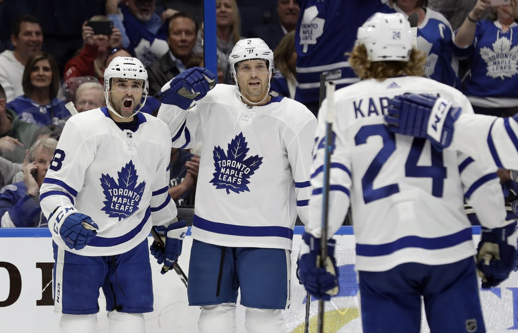 Toronto Maple Leafs center Nazem Kadri (43) celebrates his goal against the Tampa Bay Lightning with defenseman Ron Hainsey (2) and right wing Kasperi