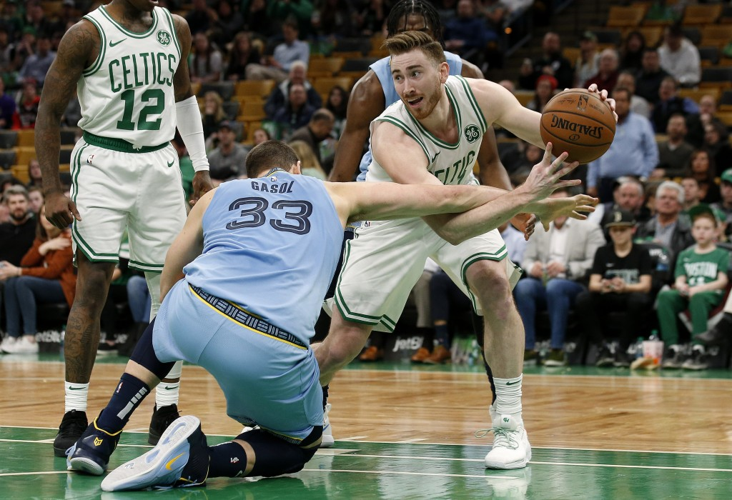 Memphis Grizzlies' Marc Gasol (33) tries to knock the ball away from Boston Celtics' Gordon Hayward during the second half of Boston's 122-116 win in