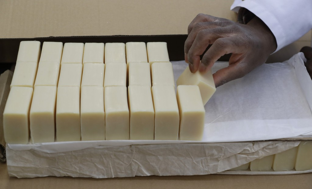 In this photo taken on Thursday, Jan. 17, 2019, bars of soap are packed at the Clarity-The Soap Co. premises in London. Amid the rancor and political