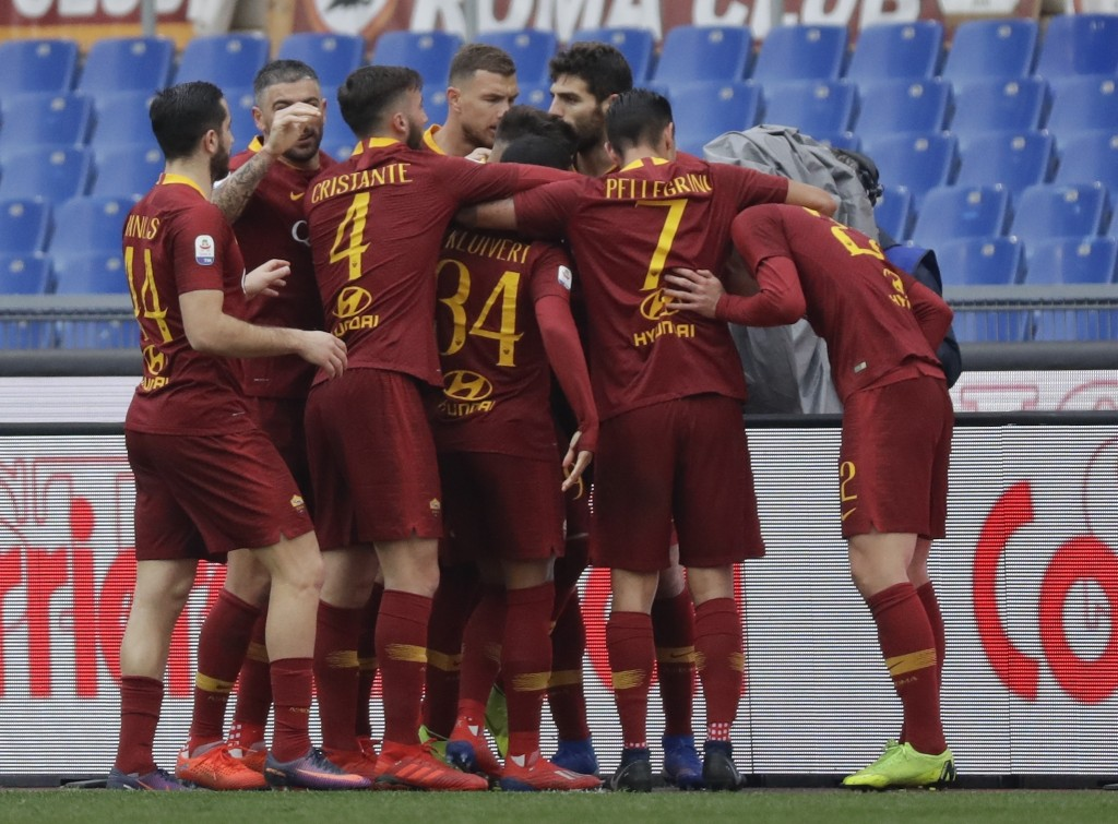 Roma players celebrate after Nicolo' Zaniolo scored their side's opening goal during a Serie A soccer match between Roma and Torino, at the Rome Olymp