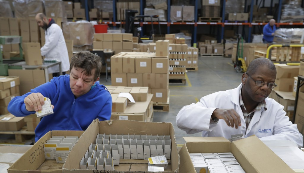 In this photo taken on Thursday, Jan. 17, 2019, David Wright, left, and Dan During, right, pack bars of soap at the Clarity-The Soap Co. premises in L