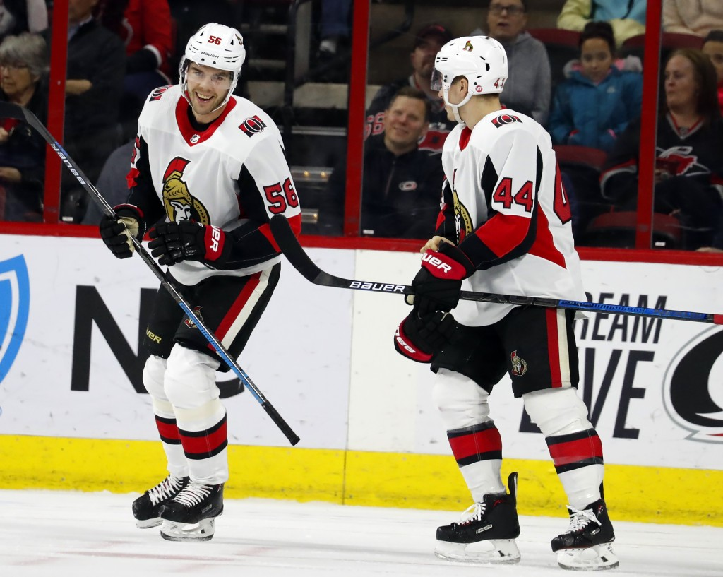 Ottawa Senators' Magnus Paajarvi (56) celebrates his goal with teammate Jean-Gabriel Pageau (44) during the first period of an NHL hockey game against...