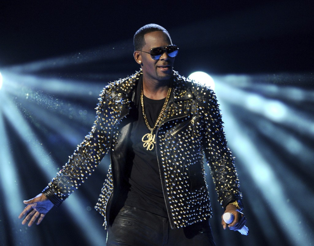 FILE - In this June 30, 2013 file photo, R. Kelly performs at the BET Awards in Los Angeles. Multiple outlets have reported that Sony Music has droppe...