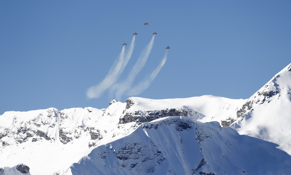 The Patrouille Suisse, an aerobatic team of the Swiss Air Force, flies ahead of an alpine ski, men's World Cup downhill, in Wengen, Switzerland, Satur