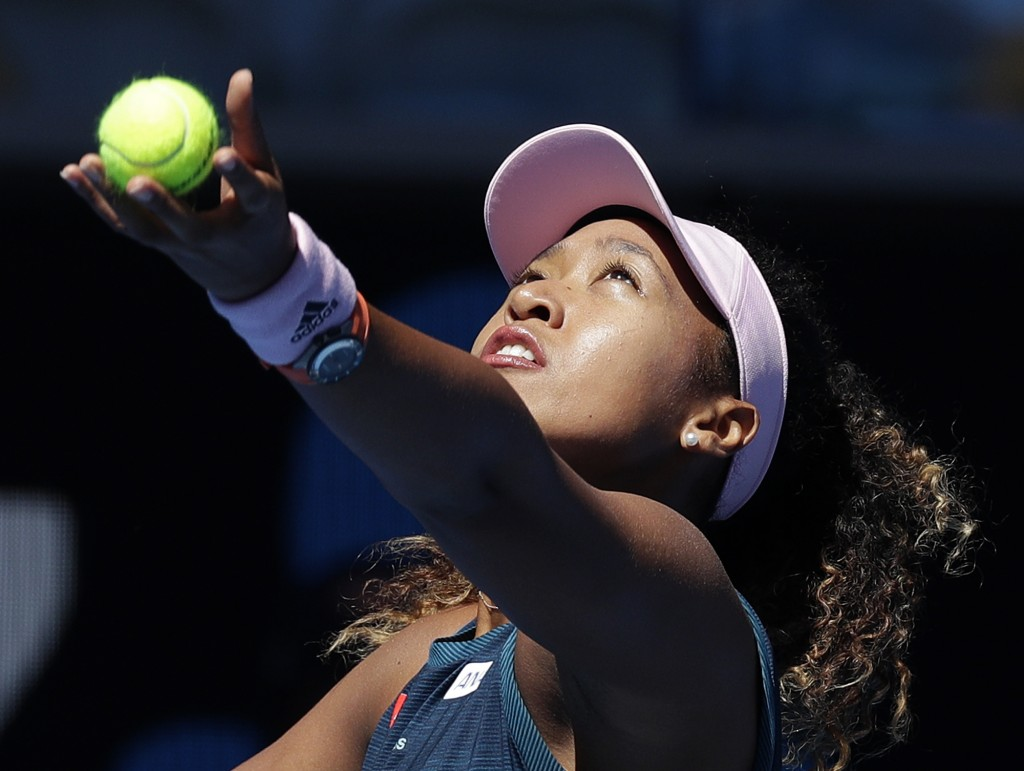 Japan's Naomi Osaka serves to Taiwan's Hsieh Su-Wei during their third round match at the Australian Open tennis championships in Melbourne, Australia...