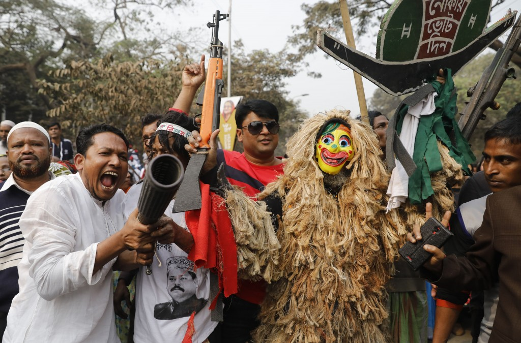 Supporters of the Awami League political party play with toy guns during a rally celebrating the party's overwhelming victory in last month's election...