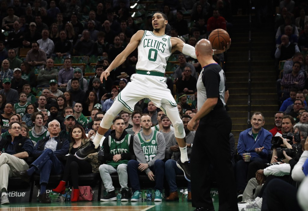 1a8102fde40c Boston Celtics  Jayson Tatum leaps to keep the ball in play during the  first quarter