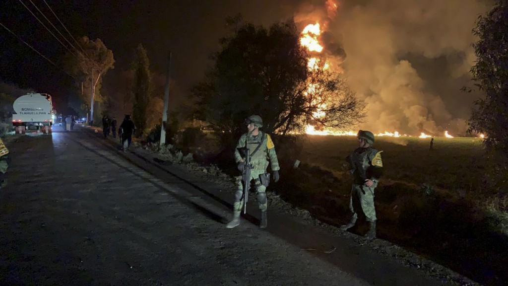 In this image provided by the Secretary of National Defense, soldiers guard in the area near an oil pipeline explosion in Tlahuelilpan, Hidalgo state,...