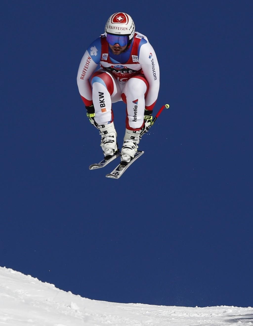 Switzerland's Beat Feuz competes during an alpine ski, men's World Cup downhill in Wengen, Switzerland, Saturday, Jan. 19, 2019. (AP Photo/Gabriele Fa...