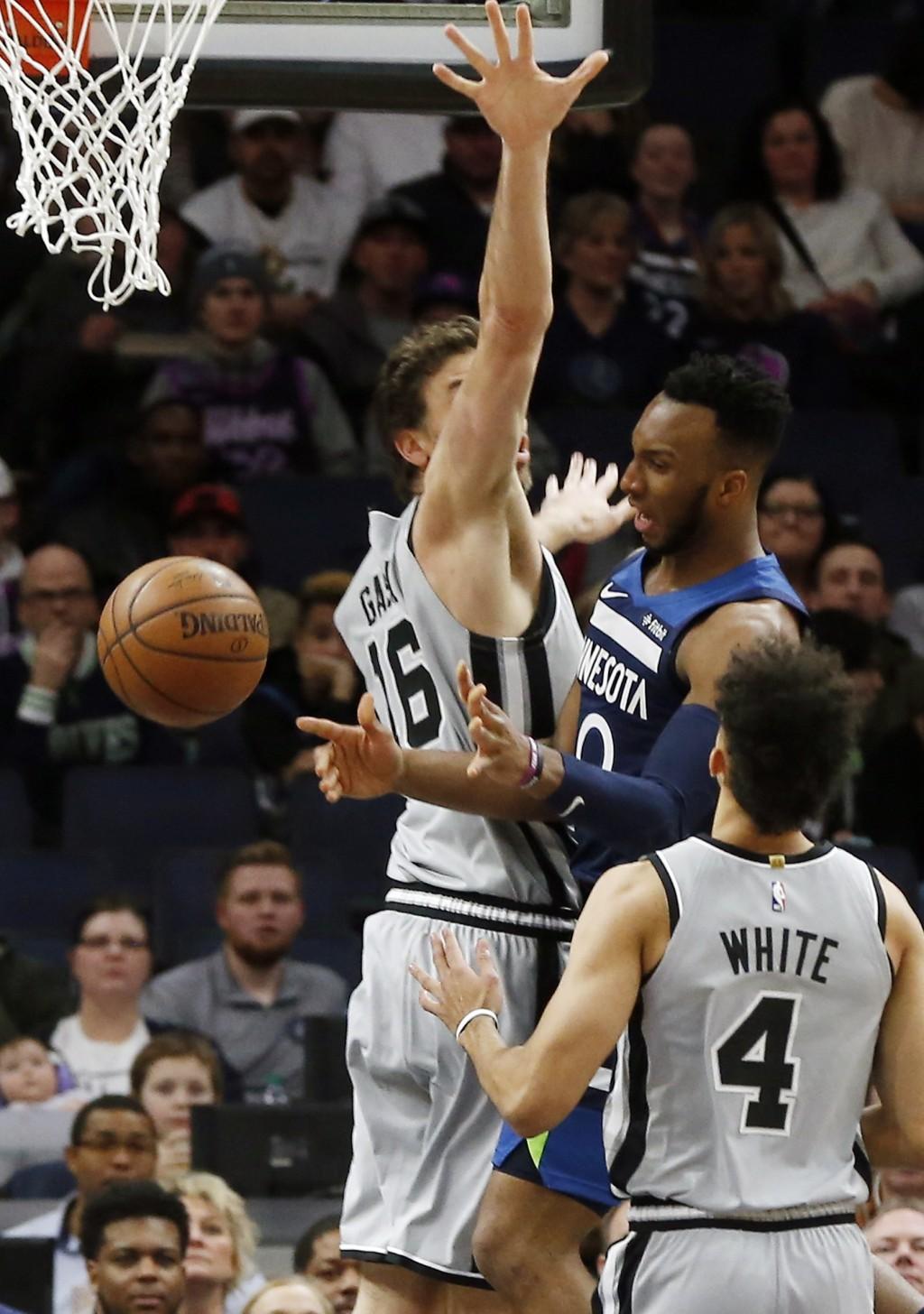 San Antonio Spurs' Pau Gasol, left, of Spain, causes Minnesota Timberwolves' Josh Okogie of Nigeria to lose the ball in the first half of an NBA baske
