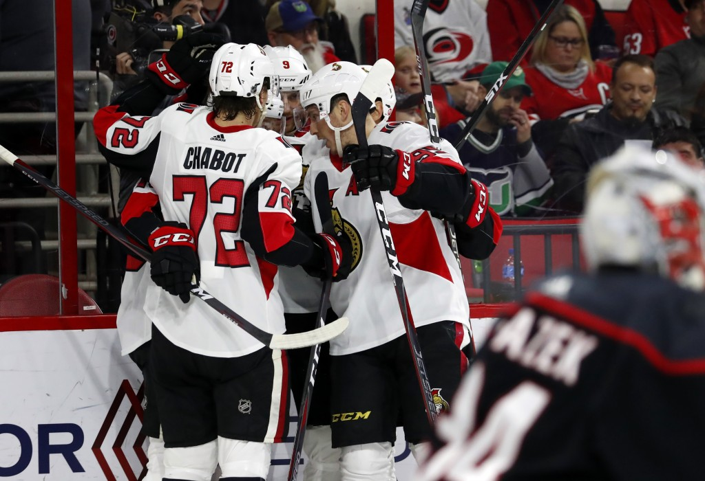 The Ottawa Senators celebrate a goal by Bobby Ryan during the second period of an NHL hockey game against the Carolina Hurricanes, Friday, Jan. 18, 20