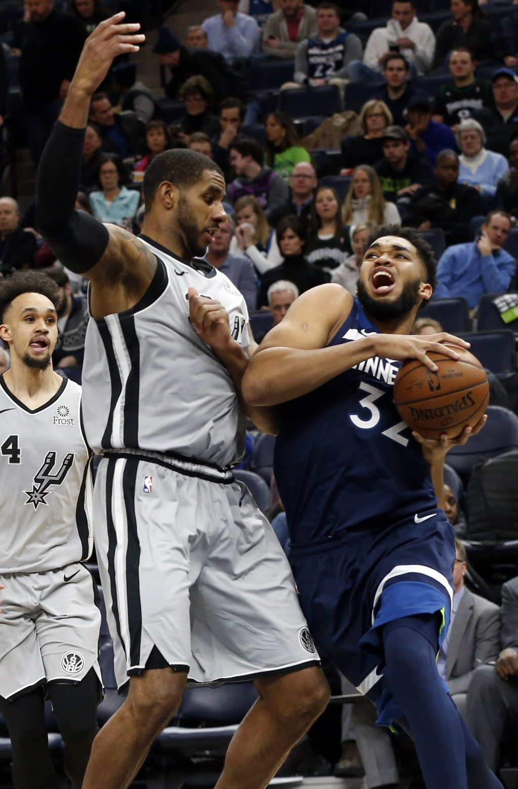 Minnesota Timberwolves' Karl-Anthony Towns, right, drives around San Antonio Spurs' LaMarcus Aldridge during the second half of an NBA basketball game
