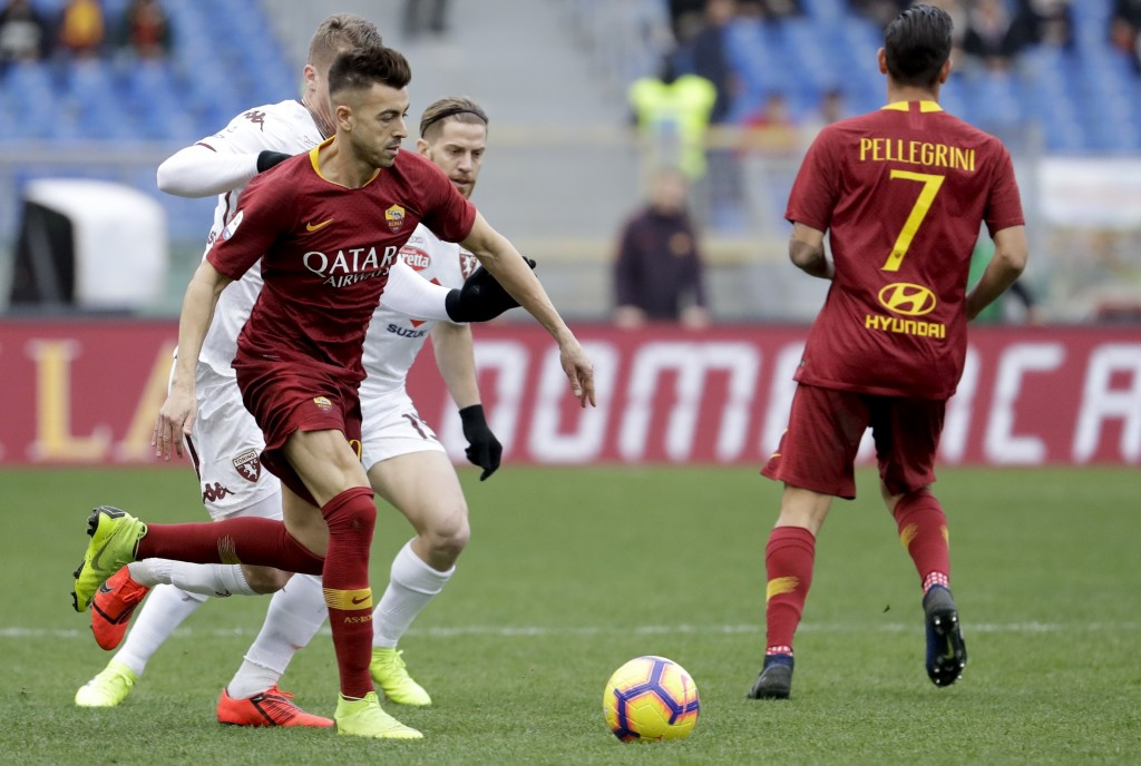 Roma's Stephan El Sharaawy runs with the ball during a Serie A soccer match between Roma and Torino, at the Rome Olympic Stadium, Saturday, Jan. 19, 2