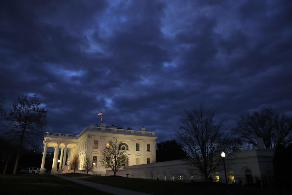 In this Jan. 8, 2019, photo, clouds roll over the White House, Tuesday Jan. 8, 2019, in Washington. The partial government shutdown is hitting home fo
