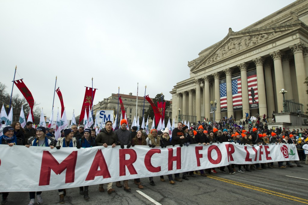Anti-abortion activists march towards the U.S. Supreme Court during the March for Life in Washington Friday, Jan. 18, 2019. (AP Photo/Jose Luis Magana