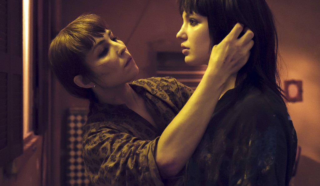 "This image released by Netflix shows Noomi Rapace, left, and Sophie Nélisse in a scene from ""Close."" Rapace portrays a counter-terrorism expert and bo"
