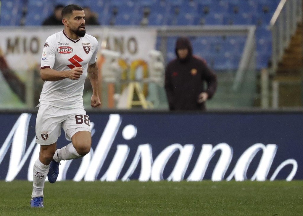 Torino's Tomas Rincon celebrates after scoring his side's opening goal during a Serie A soccer match between Roma and Torino, at the Rome Olympic Stad