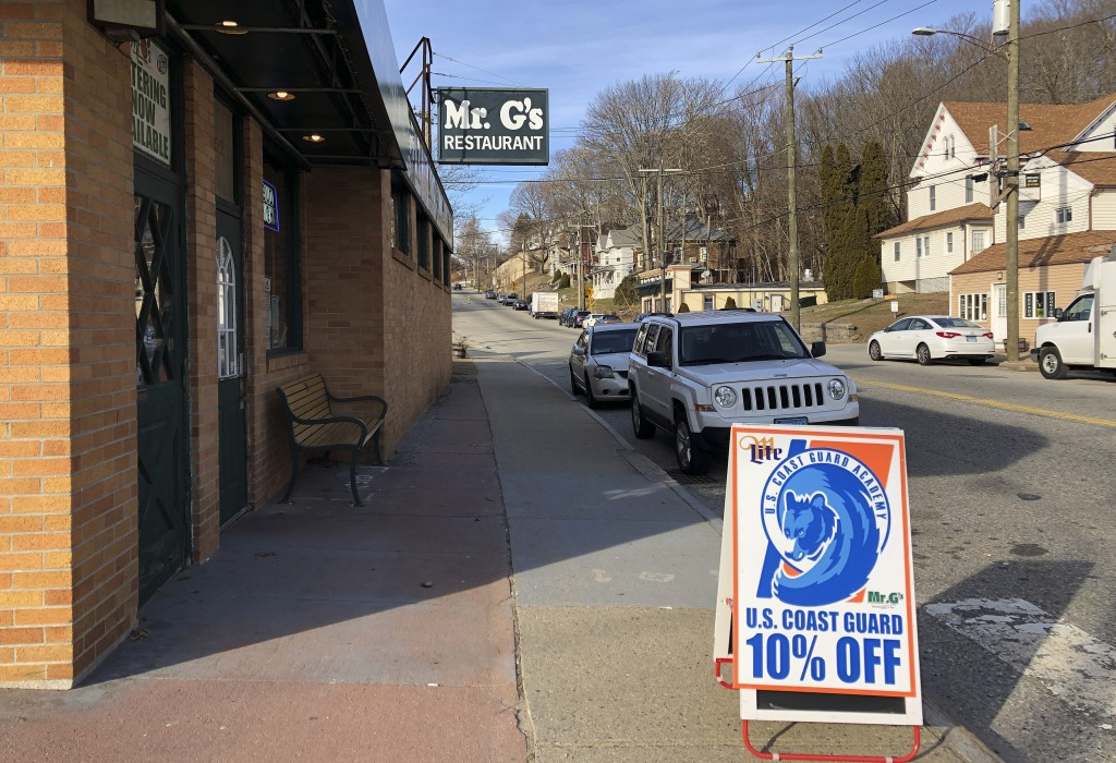 In this Thursday, Jan. 17, 2019 photo, a sign advertises a discount offered by Mr. G's in New London, Conn., to the hundreds of civilian and non-civil...