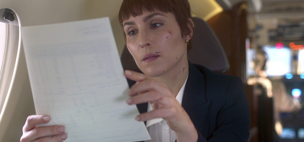 """This image released by Netflix shows Noomi Rapace in a scene from """"Close."""" Rapace portrays a counter-terrorism expert and bodyguard who gets enlisted"""
