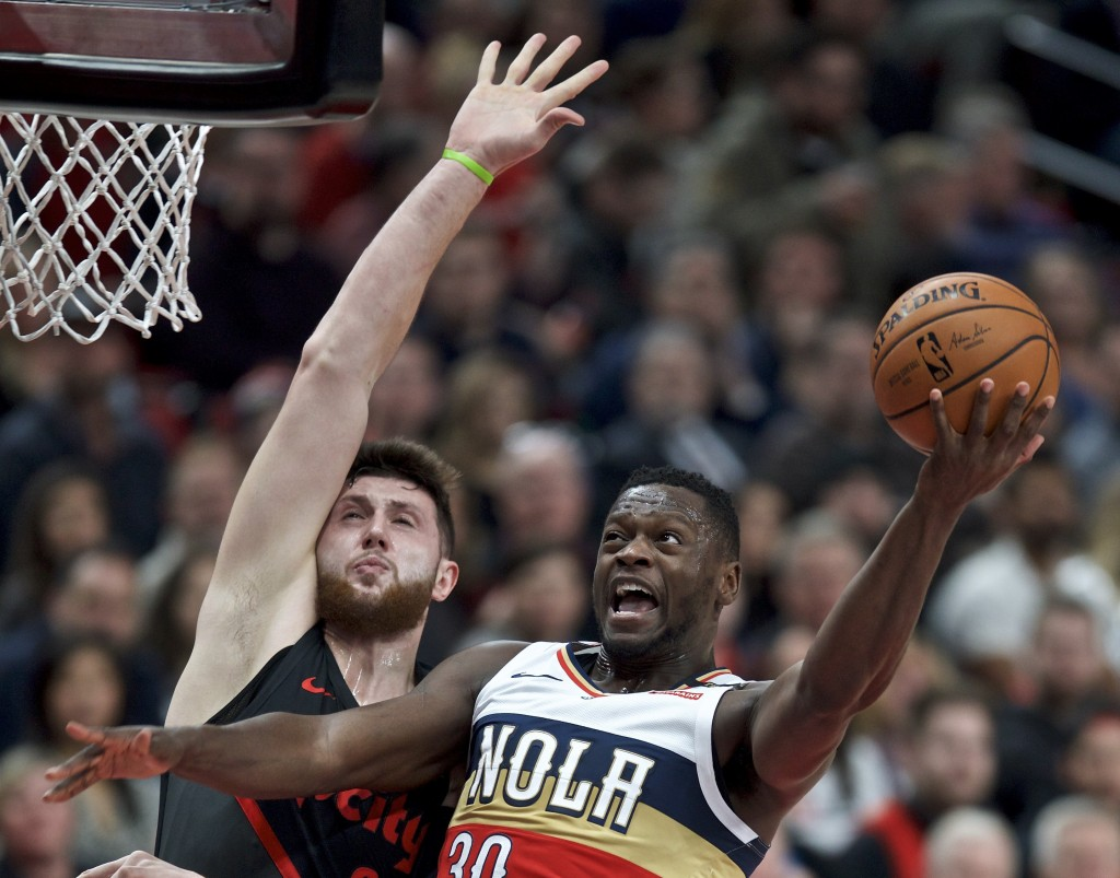 New Orleans Pelicans forward Julius Randle, right, shoots as Portland Trail Blazers center Jusuf Nurkic defends during the first half of an NBA basket...