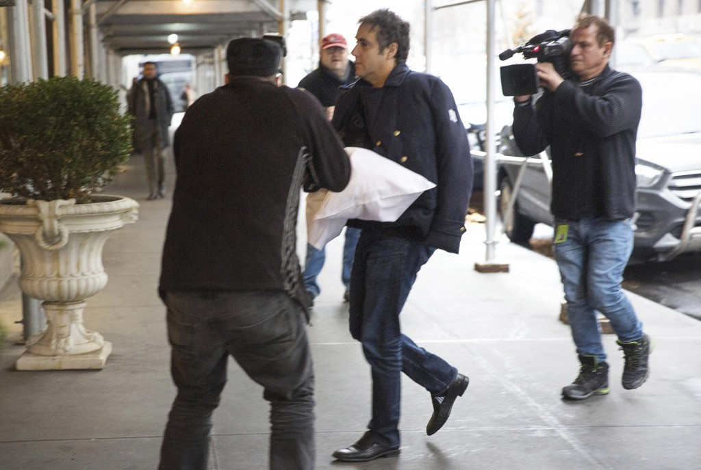 ADDS THAT COHEN'S LEFT ARM IS IN A SLING - Michael Cohen arrives at his home in New York with his left arm in a sling supported by a pillow Friday, Ja
